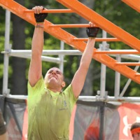 photo of PLM worker doing toughmudder